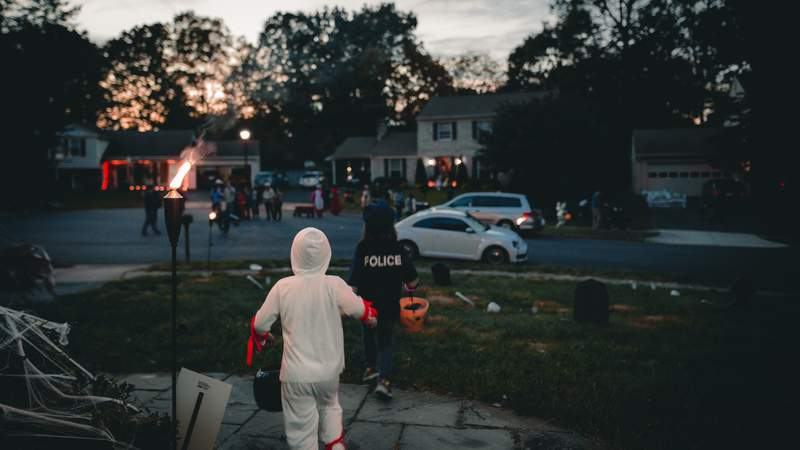 Kids out trick-or-treating for Halloween.