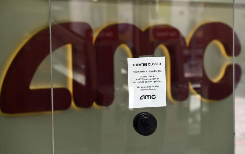 FILE - In this April 29, 2020 file photo, a message on the ticket window at the AMC Burbank 16 movie theaters complex informs potential customers that it is currently closed in Burbank, Calif.  AMC says its business is suffering because of the coronavirus pandemic and it may not survive. All of the companys theaters are shut down through June, and while the theaters are closed the company is generating no revenue.   (AP Photo/Chris Pizzello, File)