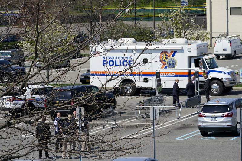 Emergency service personnel work at the scene of a shooting at a Stop & Shop supermarket, Tuesday, April 20, 2021, in West Hempstead, N.Y.  A gunman shot three workers inside a manager's office at a Long Island grocery store Tuesday police said.  (AP Photo/Mary Altaffer)