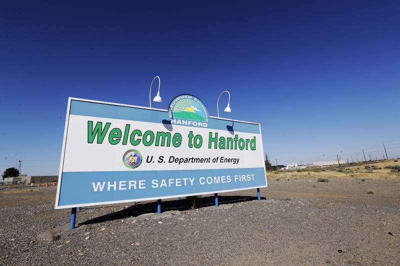 FILE - In this Aug. 13, 2019, file photo, a sign at the Hanford Nuclear Reservation is posted near Richland, Wash. Officials say an underground nuclear waste storage tank that dates to World War II appears to be leaking contaminated liquid into the ground. The U.S. Department of Energy said Thursday, April 29, 2021, that Tank B-109 holds 123,000 gallons of radioactive waste left from the production of plutonium for nuclear weapons on the Hanford Nuclear Reservation. (AP Photo/Elaine Thompson, File)
