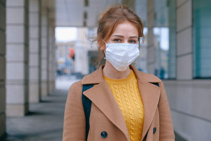 A woman wears a face mask.