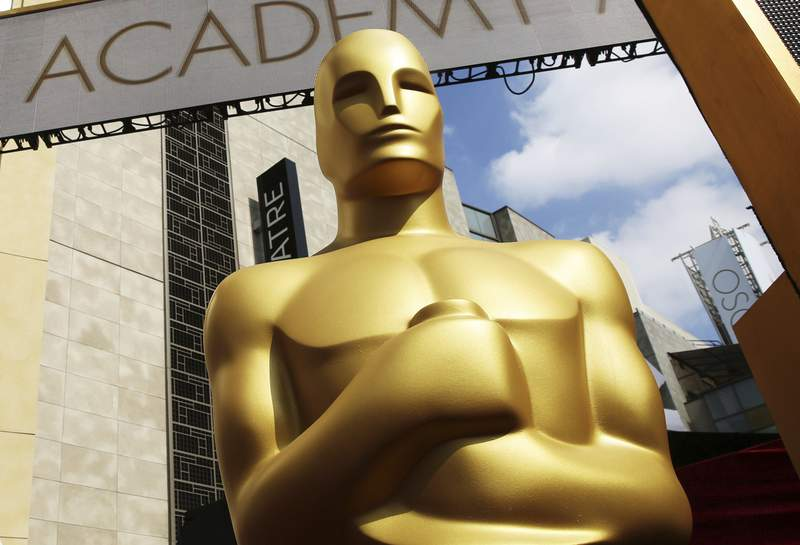 FILE - In this Feb. 21, 2015 file photo, an Oscar statue appears outside the Dolby Theatre for the 87th Academy Awards in Los Angeles.  (Photo by Matt Sayles/Invision/AP, File)