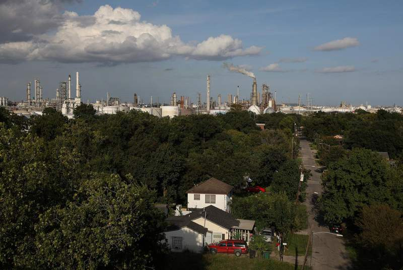 A house stands in the Manchester neighborhood while refineries are visible in the background in Houston on Sept. 8, 2018. (Credit: REUTERS/Loren Elliott)