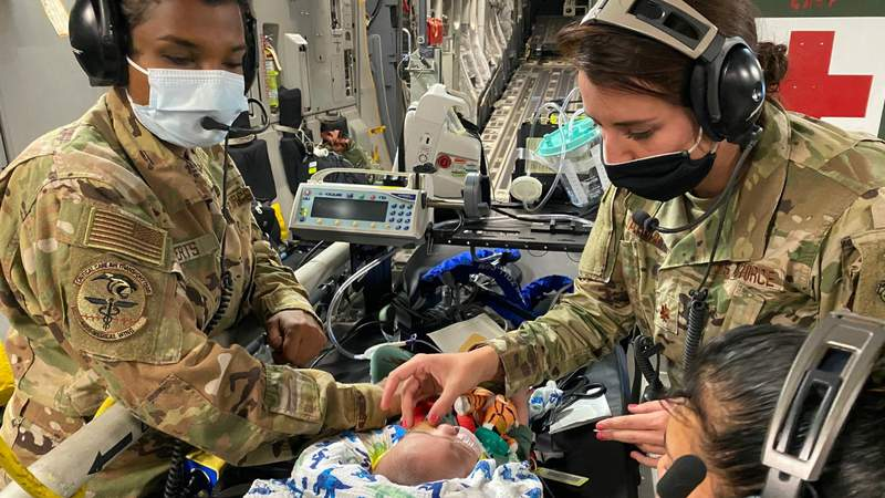 A 59th Medical Wing Pediatric Critical Care Air Transport Team provides care to a five-month-old patient on board a C-17 Globemaster III headed to California, Oct. 9, 2020. The patient and his family were traveling from the neonatal intensive care unit in Hawaii to Texas. Contributed photo.
