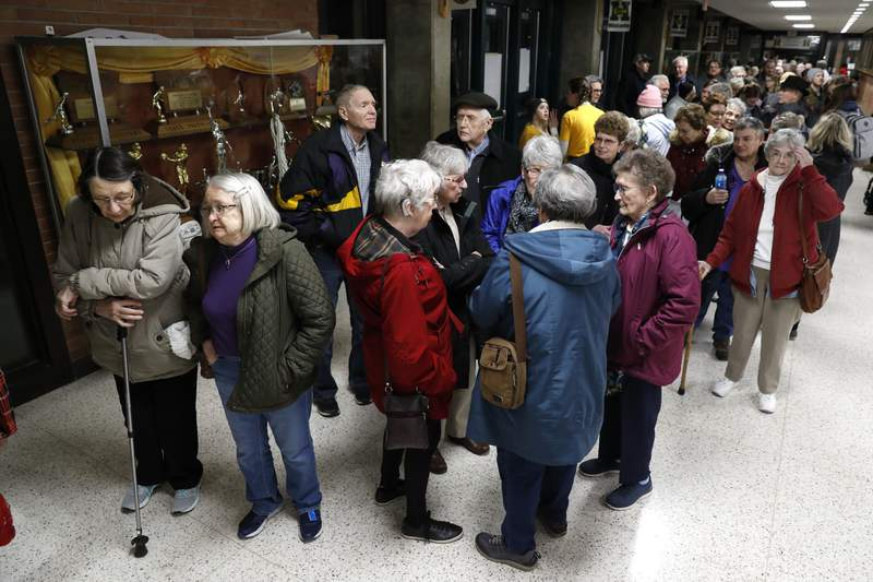 Local residents wait to enter an Iowa Democratic caucus at Hoover High School, Monday, Feb. 3, 2020, in Des Moines, Iowa. (AP Photo/Charlie Neibergall)