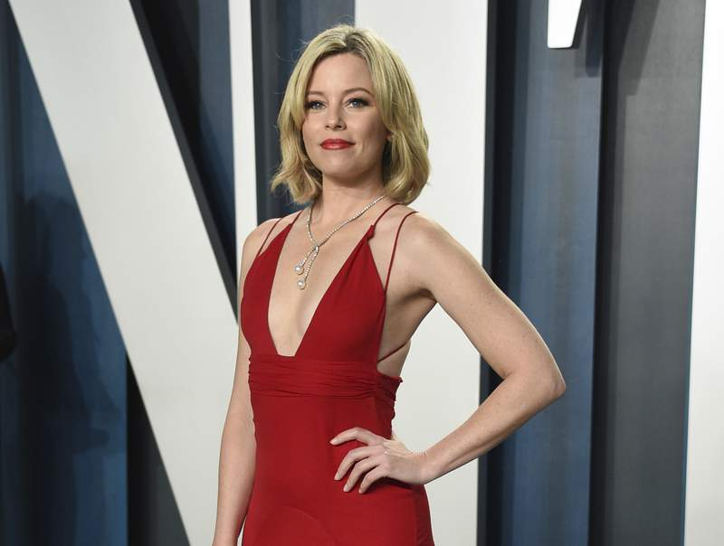 """FILE - In this Feb. 9, 2020 file photo, actress Elizabeth Banks arrives at the Vanity Fair Oscar Party in Beverly Hills, Calif. Banks will play the manic science teacher Ms. Frizzle in a live-action film """"The Magic School Bus,"""" based on the animated TV show that ran 1994 to 1997. (Photo by Evan Agostini/Invision/AP, File)"""