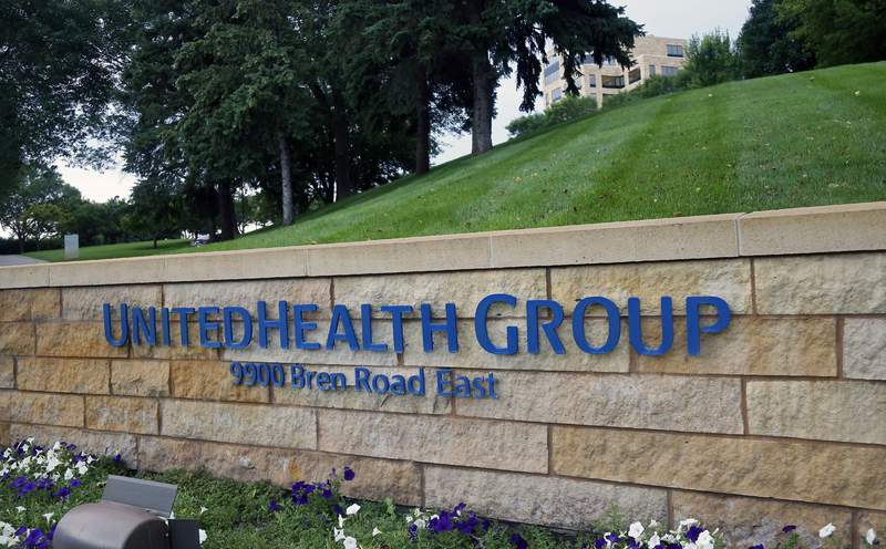 This July 12, 2019, photo shows the UnitedHealthcare headquarters in Minneapolis. UnitedHealth Group beat forecasts for its earnings in the third quarter, and the U.S.'s largest health insurance provider finally hiked its 2020 outlook after holding off while trying to sort out COVID-19s impact. (AP Photo/Jim Mone, File)