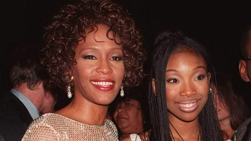 """Whitney Houston and Brandy at the premiere of the all new version of """"Rodgers and Hammerstein's Cinderella"""" in 1997."""