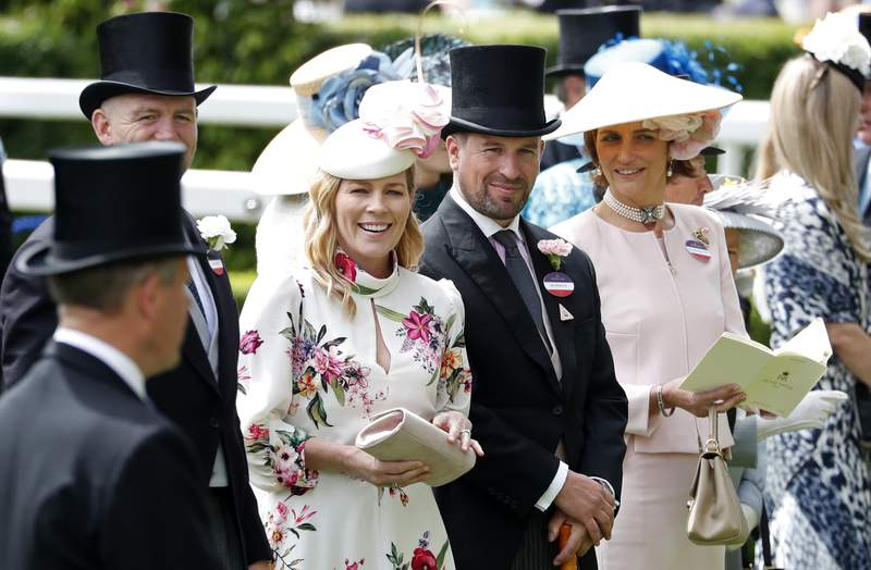 FILE - In this Thursday June 20, 2019 file photo, Peter Phillips and Autumn Phillips attends the third day of the annual Royal Ascot horse race meeting, which is traditionally known as Ladies Day, in Ascot, England. Peter Phillips, the eldest grandson of Queen Elizabeth II, and his wife Autumn are divorcing after 12 years of marriage. The couple said in a statement Tuesday Feb. 11, 2020, that separation was sad but amicable. (AP Photo/Alastair Grant, File)