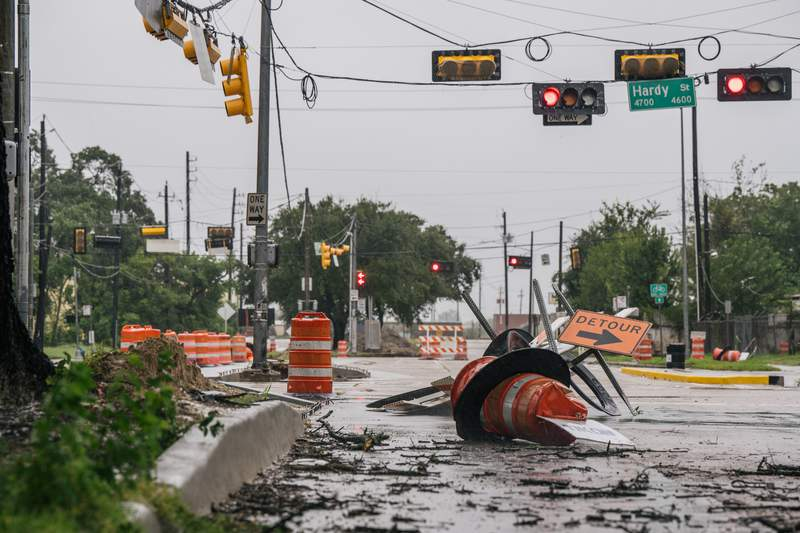 HOUSTON, TEXAS - SEPTEMBER 14: Debris and damaged road construction are left after Tropical Storm Nicholas moved through the area on September 14, 2021 in Houston, Texas. Tropical Storm Nicholas strengthened to a Category 1 hurricane as it made landfall late Monday evening, but is gradually weakening as it moves towards the Northeast. Nicholas is projected to become a tropical depression by tomorrow. (Photo by Brandon Bell/Getty Images)