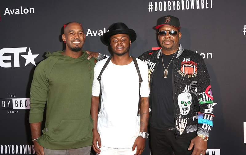 """(L-R) Landon Brown, Bobby Brown Jr., and Bobby Brown arrive at the premiere screening of """"The Bobby Brown Story"""" presented by BET and Toyota at Paramount Theater on the Paramount Studios lot on August 29, 2018 in Hollywood, California. Bobby Brown Jr. was found dead in Los Angeles on Wednesday, Nov. 18, 2020. (Photo by Maury Phillips/Getty Images for BET)"""