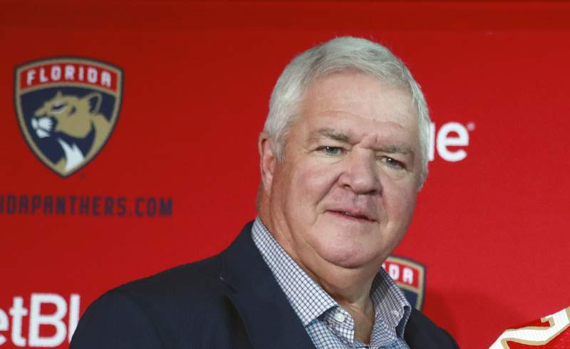 FILE - This is a July 2, 2019, file photo showing Florida Panthers President of Hockey Operations & General Manager Dale Tallon at a news conference in Sunrise, Fla. NHL deputy commissioner Bill Daly has confirmed to The Associated Press that the league is investigating allegations made against former Florida Panthers general manager Dale Tallon for making racially insensitive comments. Daly, in an email on Friday, Aug. 28, 2020, did not provide any details of the allegations. (AP Photo/Wilfredo Lee, File)