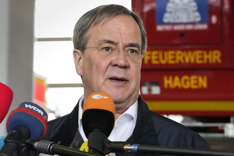 Armin Laschet, Governor of North Rhine-Westphalia and chancellor candidate of the German Christian Democrats, talks to the media at the fire station in Hagen, Germany, Thursday, July 15, 2021 after the heavy flooding in Hagen in the night before. People have died and dozens of people are missing in Germany after heavy flooding turned streams and streets into raging torrents, sweeping away cars and causing some buildings to collapse.   (AP Photo/Martin Meissner)