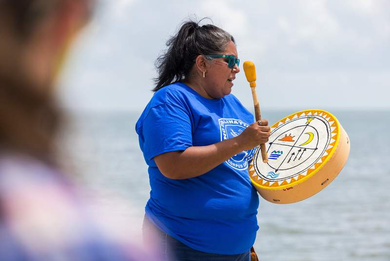 Love Sanchez, of the Indigenous People of the Coastal Bend, participates in a prayer ceremony at McGee Beach in Corpus Christi in protest of the expansion of the Moda Ingleside Energy Center on Aug. 28, 2021.