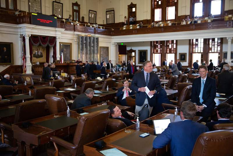 Lawmakers on the House floor on Aug. 23, 2021.