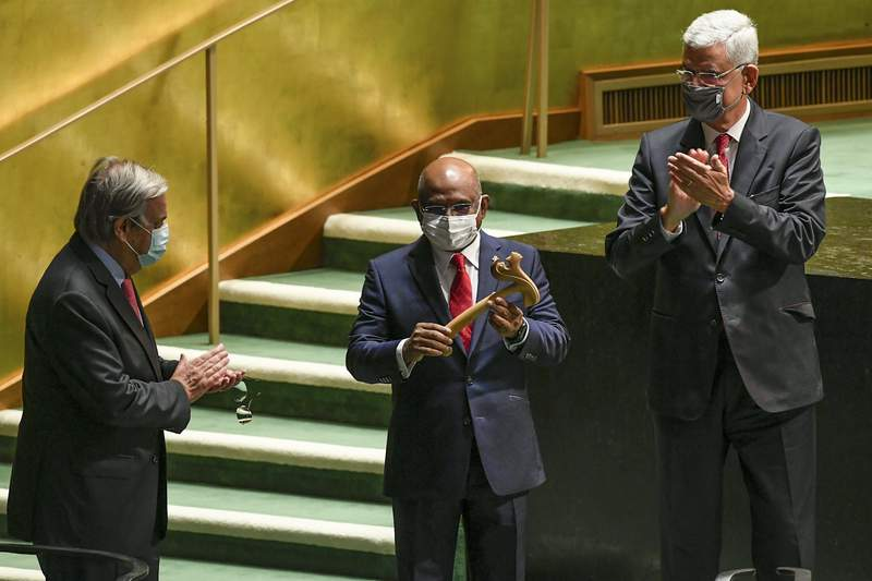 FILE - In this Tuesday, Tuesday, Sept. 14, 2021, file photo provided by United Nations, U.N. Secretary-General Antnio Guterres, left, and Volkan Bozkir, right, president of the 75th session of the United Nations General Assembly, applaud as Abdulla Shahid, center, receives the gavel as the new president of the 76th session of the UNGA at U.N. headquarters. World leaders will have to be vaccinated against the coronavirus to speak at the U.N. General Assembly's big meeting next week, the assembly leader and New York City officials said this week, prompting swift objections from at least one nation.(Evan Schneider/United Nations Photo via AP, File)