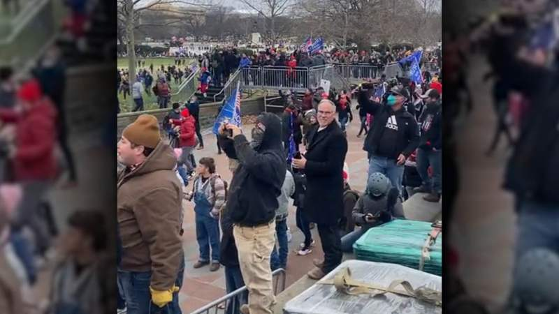 A video posted to Parler shows Texas State Representative Kyle Biedermann standing near the steps of the U.S. Capitol around 1 p.m. on January 6, 2021.