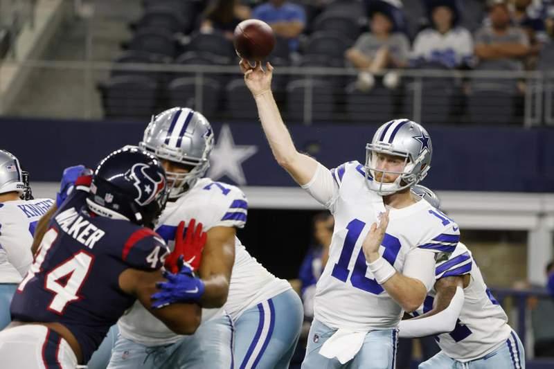 Houston Texans defensive end DeMarcus Walker (44) pressures as Dallas Cowboys quarterback Cooper Rush (10) throws a pass in the first half of a preseason NFL football game in Arlington, Texas, Saturday, Aug. 21, 2021.