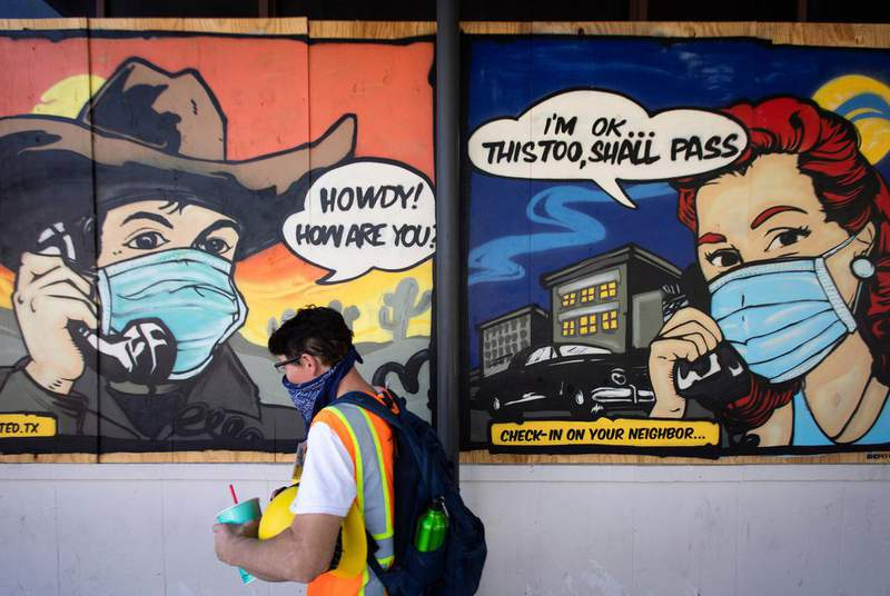 COVID-19 related street art on Sixth Street in downtown Austin on May 6th, 2020. (Credit: Miguel Gutierrez Jr./The Texas Tribune)