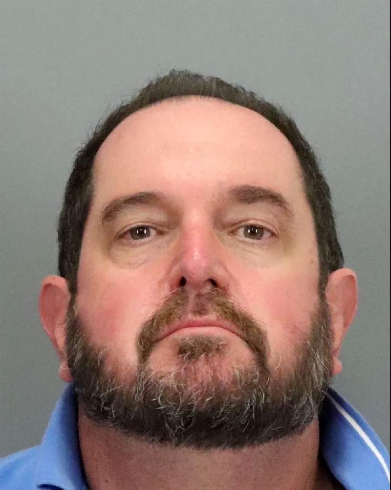"This booking photo provided by the Santa Clara County Sheriff's Office shows Alan Viarengo, 55. Authorities say Viarengo, a California community college instructor with ties to the far-right, anti-government ""boogaloo"" movement is in custody following his arrest for allegedly sending more than two dozen threatening letters to a county health officer during the coronavirus pandemic. The Santa Clara County Sheriff's Office arrested Viarengo, last week and seized large amounts of firearms and explosives from his family's home. (Santa Clara County Sheriff's Office via AP)"