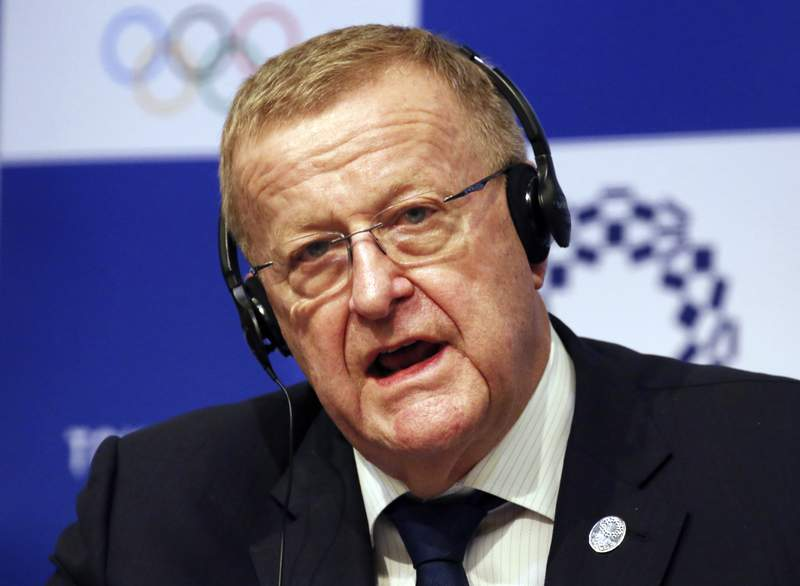 FILE - In this Dec. 5, 2018, file photo, John Coates, the leader of the IOC's coordination commission for the Tokyo Olympics, speaks during a press conference in Tokyo. The International Olympic Committee and Japanese organizers are trying to remove public doubts that the postponed Tokyo Olympics will take place next year despite the COVID-19 pandemic. Tokyo organizing committee CEO Toshiro Muto said last week that the games could go ahead without a vaccine. This week John Coates, the IOC member from Australia who oversees the Tokyo Olympics, said the games would happen despite the pandemic.(AP Photo/Koji Sasahara, File)