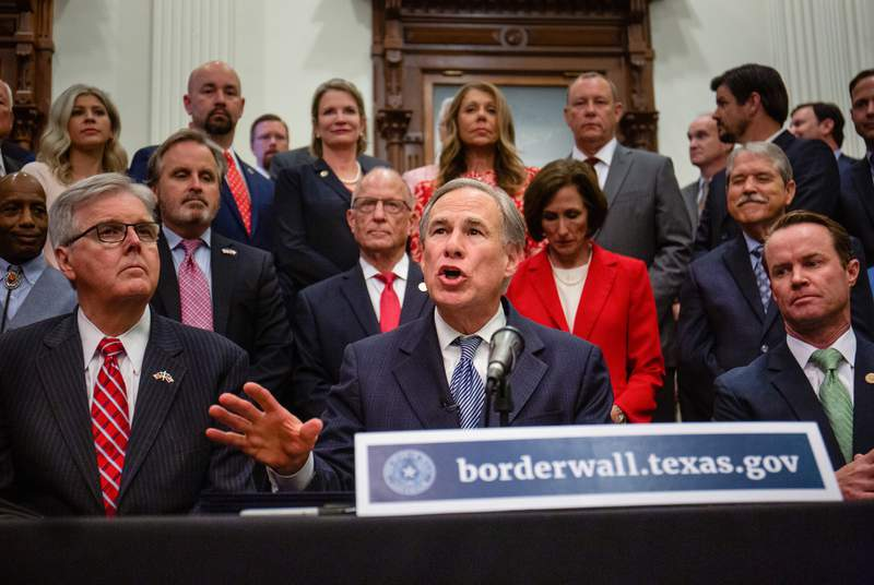 Flanked by Lt. Gov. Dan Patrick and House Speaker Dade Phelan, Gov. Greg Abbott held a press conference at the Capitol on June 16, 2021 to provide more details on his plan for Texas to build its own border wall.