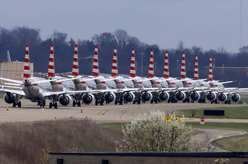 American Airlines planes stored at Pittsburgh International Airport sit idle on a closed taxiway in Imperial, Pa., on Tuesday, March 31, 2020.