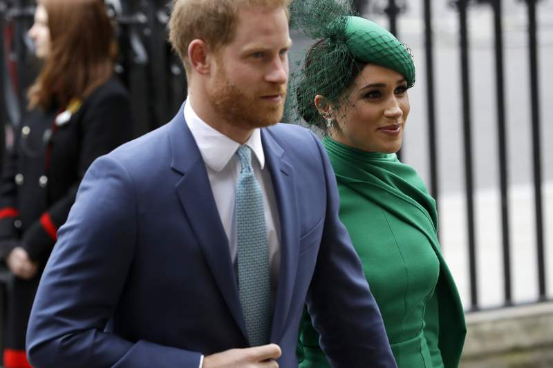 FILE - In this Monday, March 9, 2020 file photo, Britain's Harry and Meghan the Duke and Duchess of Sussex arrive to attend the annual Commonwealth Day service at Westminster Abbey in London. Prince Harry has repaid 2.4 million pounds ($3.2 million) in British taxpayers money that was used to renovate the home intended for him and his wife Meghan before they gave up royal duties. A spokesman on Monday, Sept. 7, 2020 Harry has made a contribution to the Sovereign Grant, the public money that goes to the royal family. (AP Photo/Kirsty Wigglesworth, file)