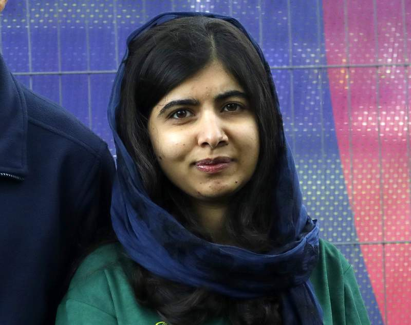 FILE - Malala Yousafzai, Pakistani Nobel Peace Prize winner, appears at the Cricket World Cup opening party along The Mall in London, on May 29, 2019. Yousafzai announced Monday that she has partnered with Apple TV Plus in an exclusive, multi-year content deal to develop dramas, documentaries, comedies, animation, and series for kids. (AP Photo/Kirsty Wigglesworth, File)