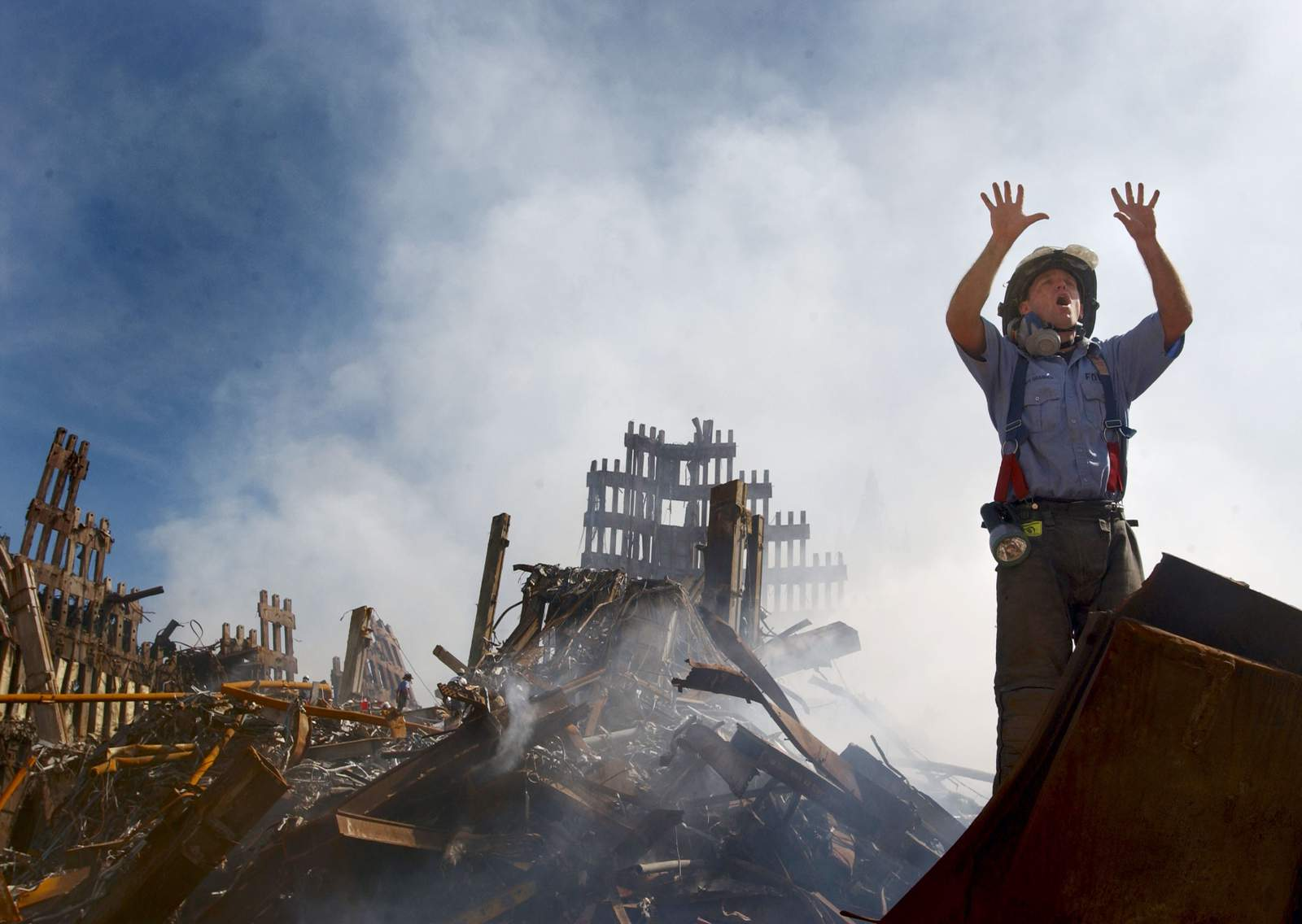 ANew York City fireman calls for 10 more rescue workers to make their way into the rubble of the World Trade Center, days after the Sept. 11, 2001 terrorist attack.