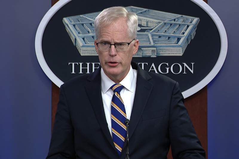 In this Tuesday, Nov. 17, 2020, image taken from a video provided by Defense.gov Acting Defense Secretary Christopher Miller speaks at the Pentagon in Washington. Miller said Tuesday that the U.S. will reduce troop levels in Iraq and Afghanistan by mid-January, asserting that the decision fulfills President Donald Trumps pledge to bring forces home from America's long wars even as Republicans and U.S. allies warn of the dangers of withdrawing before conditions are right. (Defense.gov via AP)