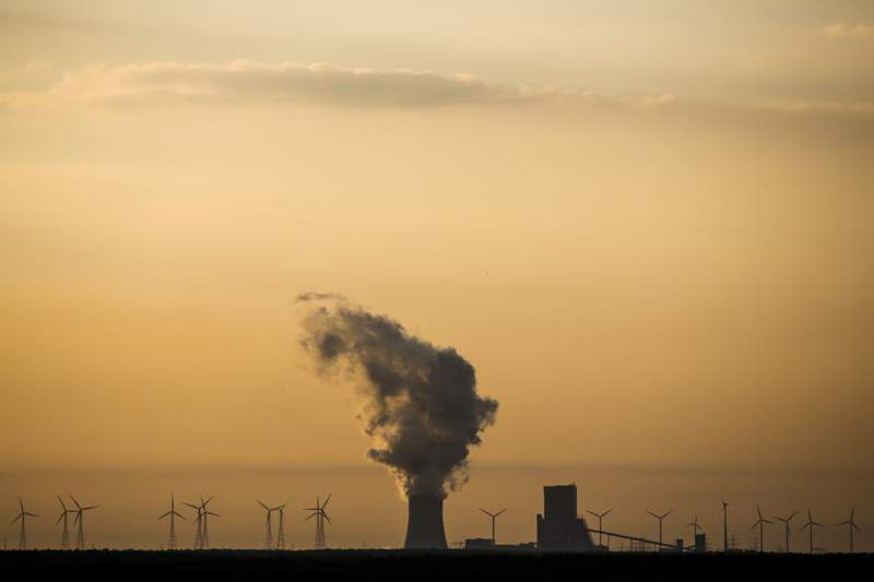 FILE - In this Tuesday, June 5, 2018 file photo, steam rises in the air from the brown coal power plant Schwarze Pumpe in the Lusatia, (Lausitz) area in Germany. Germany's greenhouse gas emissions fell sharply last year, putting the country's 2020 climate goal within reach again.(AP Photo/Markus Schreiber, file)