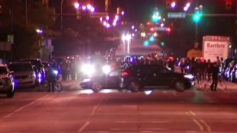 Police say 2 officers shot, wounded amid protest in Louisville