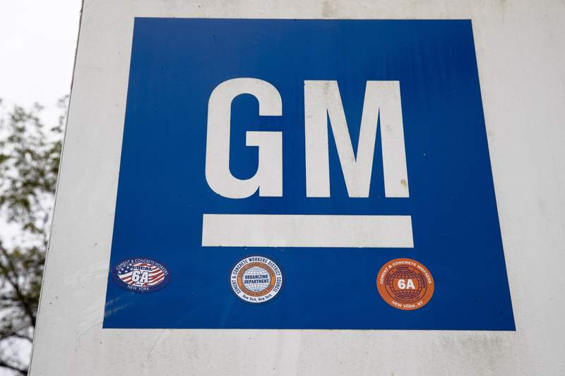 FILE - This Oct. 16, 2019, file photo shows a sign at a General Motors facility in Langhorne, Pa. Fiat Chrysler is moving to dismiss a racketeering lawsuit filed by rival General Motors, denying allegations that it bribed union officials to impose higher labor costs on GM. In papers filed Friday, Jan. 24, 2020 with the federal court in Detroit, FCA argued that GMs lawsuit is not based on facts. (AP Photo/Matt Rourke, File)