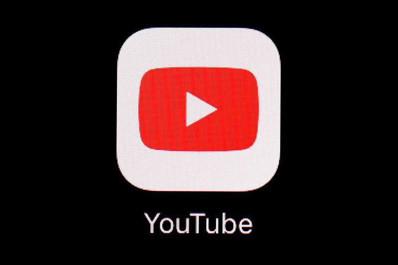 FILE - This March 20, 2018, file photo shows the YouTube app on an iPad in Baltimore.  Video-sharing tech platform YouTube on Wednesday, Sept. 29, 2021,  announced immediate bans on false claims that vaccines are dangerous and cause health issues like autism, cancer or infertility.    (AP Photo/Patrick Semansky, File)