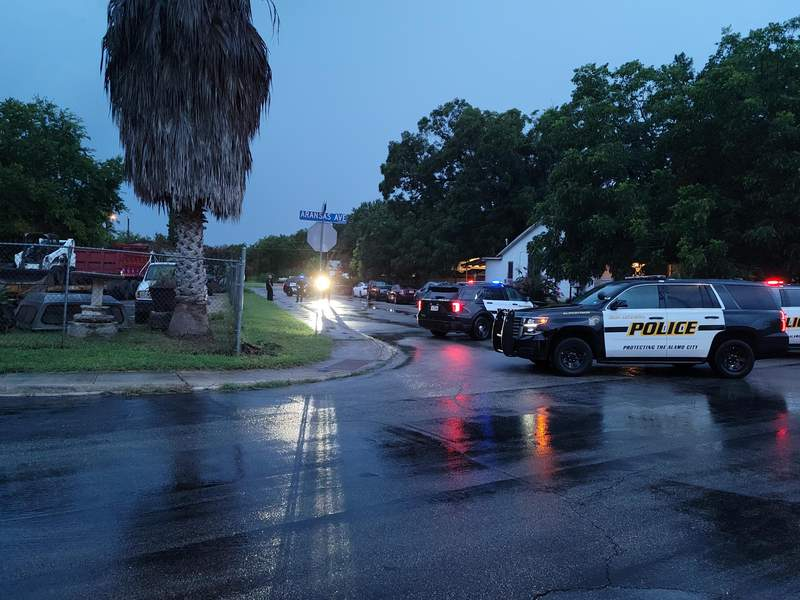 SAPD responds to a home struck by a bullet at Aransas Avenue and Lone Oak Street on Monday, Aug. 2, 2021.