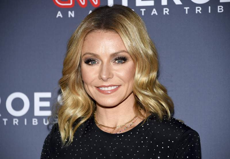 FILE - In this Dec. 9, 2018 file photo, Host Kelly Ripa attends the 12th annual CNN Heroes: An All-Star Tribute at the American Museum of Natural History in New York. Ripa is now an author.  Dey Street Books, a HarperCollins Publishers imprint, announced Tuesday, July 20, 2021, that Ripas essay collection Live Wire will come out next year.  (Photo by Evan Agostini/Invision/AP, File)