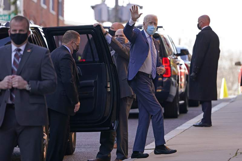 President-elect Joe Biden waves as he arrives at The Queen theater in Wilmington, Del., Monday, Dec. 7, 2020. (AP Photo/Susan Walsh)