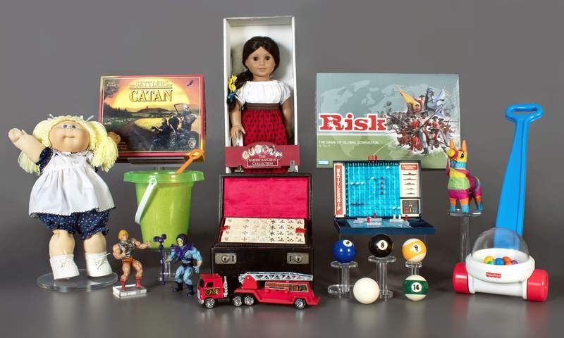 This photo provided by the National Toy Hall of Fame in Rochester, N.Y. shows the finalists being considered for induction into the hall later this year. The finalists are: American Girl Dolls, Battleship, billiards, Cabbage Patch Kids, Fisher-Price Corn Popper, Mahjong, Masters of the Universe, piata, Risk, sand, The Settlers of Catan, and toy fire engine. The winners will be chosen by a panel of experts and inducted on Nov. 4, 2021. (National Toy Hall of Fame via AP)