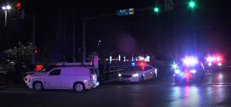 A driver was arrested on a DWI charge after San Antonio police said he ran a red light and struck a police vehicle on the Northwest Side.