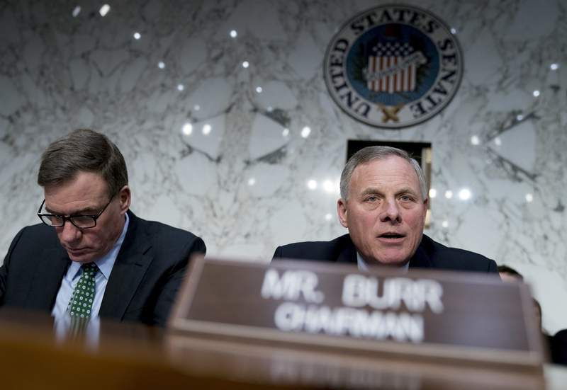 FILE - In this March 21, 2018 file photo, Senate Intelligence Chairman Richard Burr, R-N.C., right, accompanied by Committee Vice Chairman Mark Warner, D-Va., left,  before a Senate Intelligence Committee hearing on election security on Capitol Hill in Washington.  The Senate intelligence committee has concluded that the Kremlin launched an aggressive effort to interfere in the 2016 presidential contest on behalf of Donald Trump. The Republican-led panel on Tuesday released its fifth and final report in its investigation into election interference.  (AP Photo/Andrew Harnik)