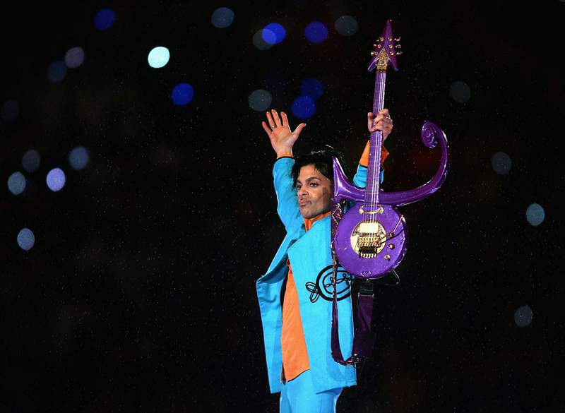 """Prince performs during the """"Pepsi Halftime Show"""" at Super Bowl XLI between the Indianapolis Colts and the Chicago Bears on February 4, 2007 at Dolphin Stadium in Miami Gardens, Florida.  (Photo by Jonathan Daniel/Getty Images)"""