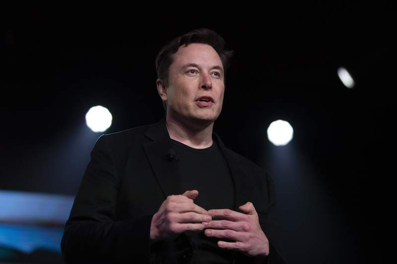 FILE - In this March 14, 2019, file photo, Tesla CEO Elon Musk speaks before unveiling the Model Y at the company's design studio in Hawthorne, Calif. (AP Photo/Jae C. Hong, File)