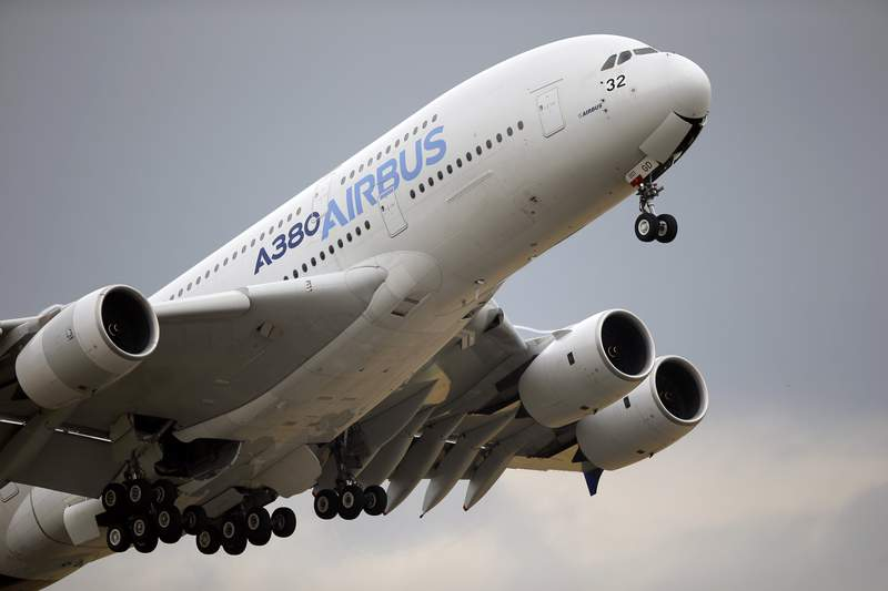 FILE - In this June 18, 2015, file photo, an Airbus A380 takes off for its demonstration flight at the Paris Air Show in Le Bourget airport, north of Paris. Commercial airliner maker Airbus is releasing 2019 earnings on Thursday, Feb. 12. (AP Photo/Francois Mori, file)