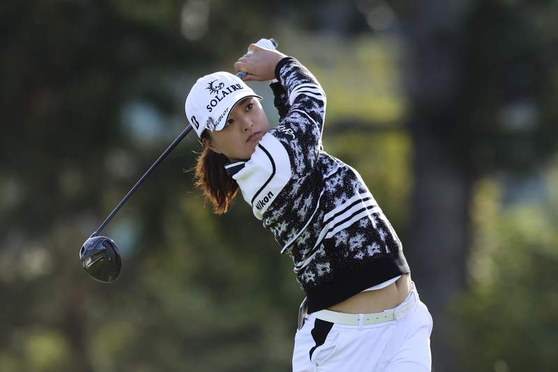 CORRECTS TO JIN YOUNG KO NOT JIN YUNG KO - Jin Young Ko, of South Korea, watches her tee shot on the second hole during the first round of the LPGA Cambia Portland Classic golf tournament in West Linn, Ore., Thursday, Sept. 16, 2021. (AP Photo/Steve Dipaola)