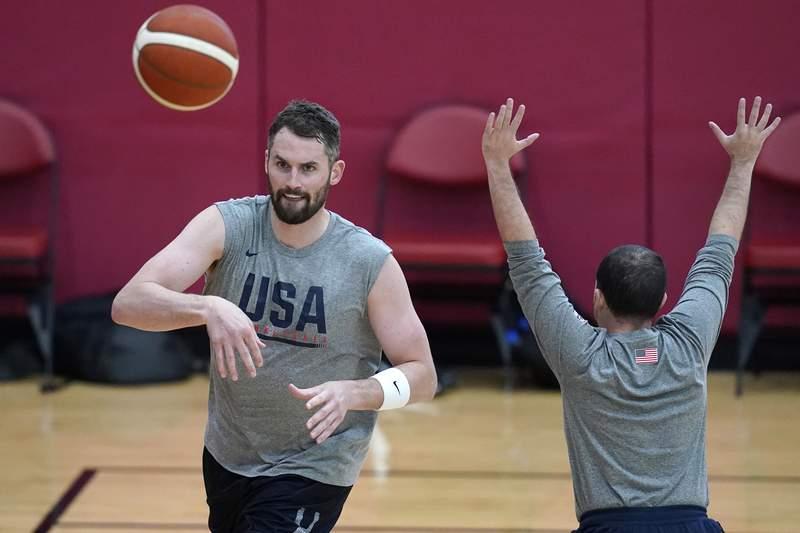 Kevin Love make a pass during practice for USA Basketball, Wednesday, July 7, 2021, in Las Vegas. (AP Photo/John Locher)