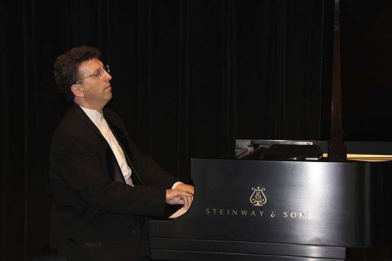 This undated photo provided by pianist/composer Jeffrey Biegel shows Biegel at Cinema Arts Centre on New York's Long Island. (Mark Lerner/Courtesy of Jeffrey Biegel via AP)