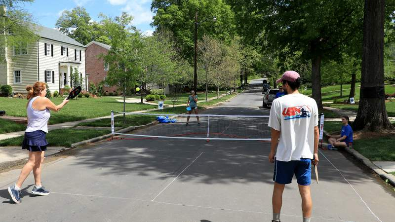 People play pickleball on an empty street during the coronavirus (COVID-19) pandemic on April 13, 2020 in Charlotte, North Carolina. Photo by Streeter Lecka