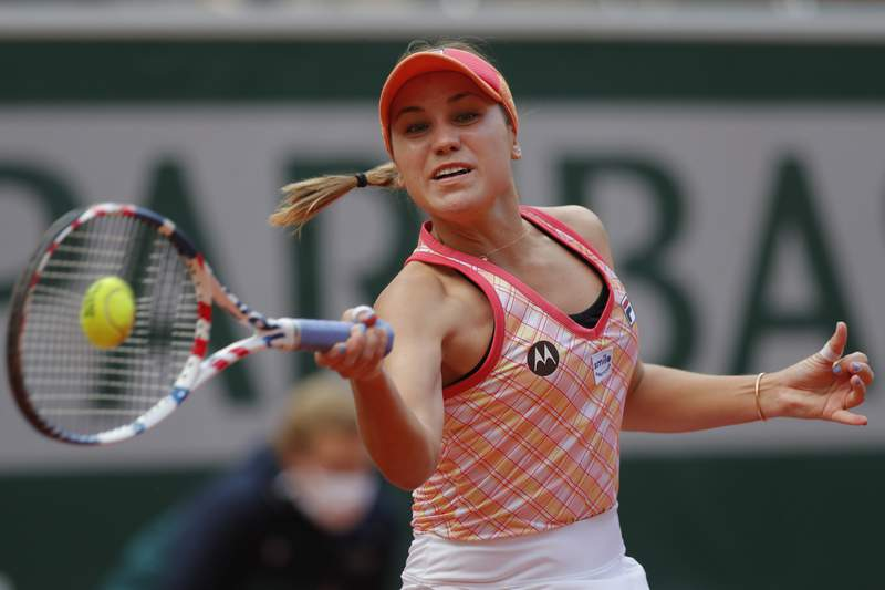 File - In this Oct. 10, 2020, file photo, Sofia Kenin, of the United States, plays a shot against Poland's Iga Swiatek in the final match of the French Open tennis tournament at the Roland Garros stadium in Paris, France. Kenin is the top-seeded woman in Abu Dhabi, where the first womens tour-level tennis event of 2021 begins main-draw play on Wednesday, Jan. 6, 2021. (AP Photo/Michel Euler, File)