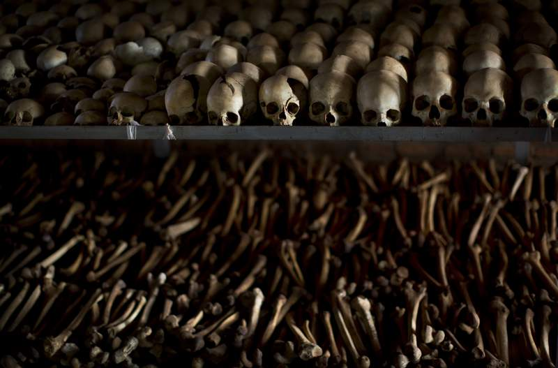 FILE - In this Friday, April 4, 2014 file photo, the skulls and bones of some of those who were slaughtered as they sought refuge inside the church are laid out as a memorial to the thousands who were killed in and around the Catholic church during the 1994 genocide in Ntarama, Rwanda. France's highest court on Wednesday Sept.30, 2020 rejected Rwandan genocide suspect Flicien Kabuga's appeal of a decision to extradite him to an international court in The Hague. Kabuga, one of the most-wanted fugitives in Rwanda's 1994 genocide, was arrested outside Paris in May after 25 years on the run. (AP Photo/Ben Curtis, File)